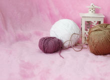 Background with skein and clew of thread. Pink background with skein and clew of thread Royalty Free Stock Photo