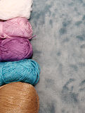 Background with skein and clew of thread. Velvet background with skein and clew of thread Royalty Free Stock Photo
