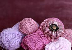 Background with skein and clew of thread. Violet background with skein and clew of thread Stock Images