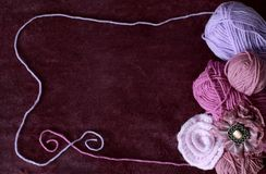 Background with skein and clew of thread. Violet background with skein and clew of thread Royalty Free Stock Images