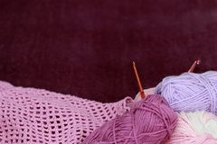 Background with skein and crochet. Violet background with skein and crochet Stock Photos