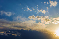 Background sky sunlight dramatic clouds. Background of sky, the sunlight streaming through dramatic clouds Stock Images