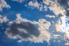 Background sky sunlight dramatic clouds. Background of sky, the sunlight streaming through dramatic clouds Royalty Free Stock Photo