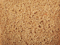 Background of slice of bread - black rye bread with yeast Royalty Free Stock Photo