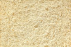 Background of a slice of freshly baked white bread close-up. Stock Image