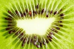 Background of slice of kiwi ablazed with light Royalty Free Stock Photography