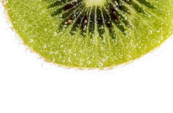 Background of slice of kiwi with water drop ablazed with light Royalty Free Stock Image