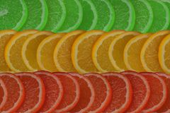 Background of sliced citruses of different colors. Background of sliced citrus red, yellow and green Royalty Free Stock Photos
