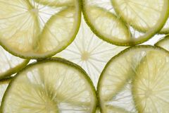 Background of sliced fresh lime close up Stock Photo