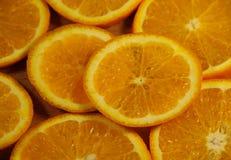 Background of sliced juicy oranges fruit Royalty Free Stock Photos