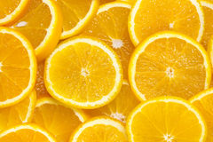 Background of sliced oranges Stock Images