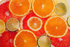 Background of  slices of citrus fruits close up Royalty Free Stock Images