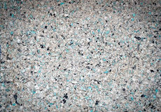Background of small blue, gray, white and black small granules w Royalty Free Stock Image