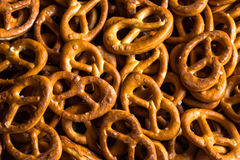 Background of the small German pretzels with salt crystals Royalty Free Stock Images