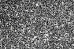 Background of small gravel of gray color. Placer of rubble. Placer of gray rubble. Light gray background Stock Images