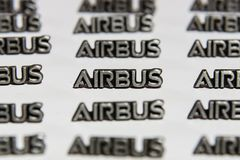 Background of small lapel pins AIRBUS. Royalty Free Stock Images