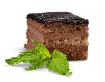 Piece of chocolate cake isolated on white. Background small luxury decoration closeup elegance fresh Stock Photography