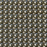 Background of small metal balls on a light background Stock Images