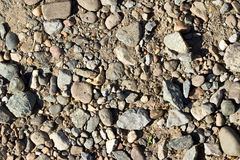 Background of small pebbles and sand Royalty Free Stock Images