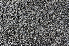 Background of small stones filled with bitumen Royalty Free Stock Images