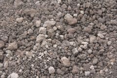 Background of Small Stones. Stones from Mount Etna. The island of Sicily, Italy. Volcanic rock. Volcanic Lava. Stone Texture for royalty free stock photo