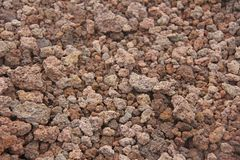 Background of Small Stones. Stones from Mount Etna. The island of Sicily, Italy. Volcanic rock. Volcanic Lava. Stone Texture for stock image
