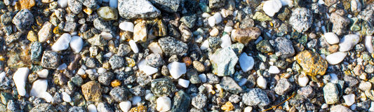 Background  with small stones under water Royalty Free Stock Photos