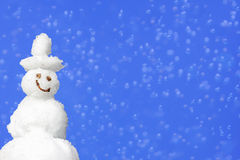 Background with smiling snowman and blur Stock Photography