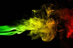 Background smoke curves and wave reggae colors green, yellow, red colored in flag of reggae music. Abstract background smoke curves and wave reggae colors green Royalty Free Stock Photography