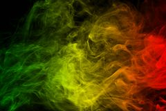 Background smoke curves and wave reggae colors green, yellow, red colored in flag of reggae music. Abstract background smoke curves and wave reggae colors green royalty free stock photo