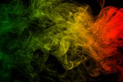 Background smoke curves and wave reggae colors green, yellow, red colored in flag of reggae music. Abstract background smoke curves and wave reggae colors green stock photo