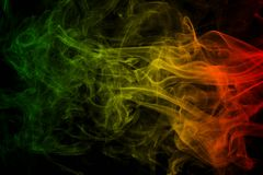 Background smoke curves and wave reggae colors green, yellow, red colored in flag of reggae music. Abstract background smoke curves and wave reggae colors green Stock Photos