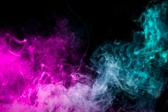 Background of smoke vape. Abstract art colored smoke on black isolated background. Stop the movement of multicolored smoke on dark background stock illustration