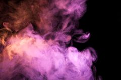 Background from the smoke of vape. Colorful pink a smoke  on a black isolated background. Background from the smoke of vape Stock Photography