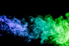 Background of smoke vape. Colorful smoke of pink and blue on a black isolated background