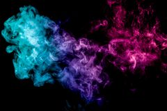 Background of smoke vape. Colorful smoke of pink and blue on a black isolated background. Background from the smoke of vape stock images