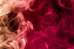 Background of smoke vape. Dense multicolored smoke of red and pink colors on a black background. Background of smoke vape stock photos