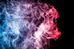 Background from the smoke of vape. Thick colorful smoke of blue and purple colors on a black isolated background. Background from the smoke of vape Stock Image