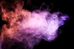 Background from the smoke of vape. Thick colorful smoke of pink, blue on a black isolated background. Background from the smoke of vape Stock Image