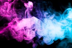 Background from the smoke of vape. Thick colorful smoke of pink, blue on a black isolated background. Background from the smoke of vape Royalty Free Stock Photos