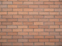 Background-Smooth Orange Brick Wall Stock Image