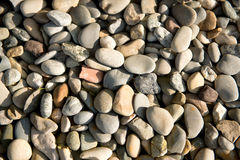 Background of smooth waterworn pebbles Royalty Free Stock Images