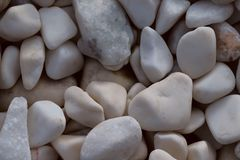 Background of smooth white pebbles. The concept of nature. stock images