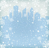 Background with snow flakes and city silhouette Stock Photos