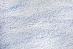 background of snow, texture, white surface with snowflakes royalty free stock photo