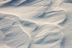Background snow waves at sunset by the wind Stock Photos