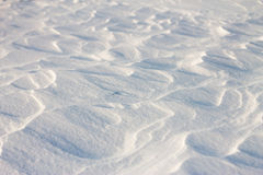 Background snow waves at sunset by the wind Stock Photo