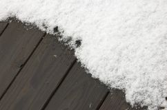 Background:snow on wooden deck Stock Photo