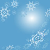 Background with snowflakes. Blue background with white snow flakes Royalty Free Stock Photography