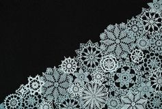 Background with snowflakes. Black background with different knitted snowflakes stock photography
